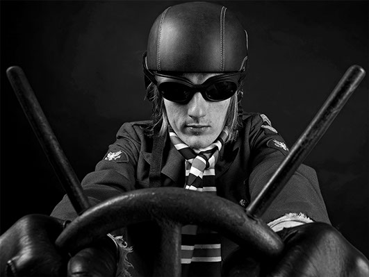 black and white portrait of a model wearing a leather helmet and pretending to drive a car with racing goggles copyright Claude HALET